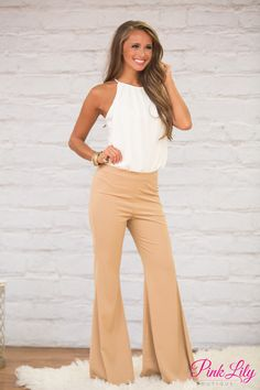 We are loving the retro vibe from this gorgeous pair of pants! Featuring a classic tan color paired with a flared bell-bottom style, it's a beautiful way to combine modern style with a vintage touch!