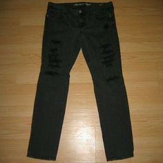 """American Eagle Faded Black Distressed Skinny Jeans These jeans are preloved but still in very good condition. They are the skinny style jean in a faded black with factory made distressing. There is black fabric that I believe is factory intended under the distressing so no skin is actually showing. Made of 99% cotton 1% spandex. Tag size is 12 Regular. Inseam is approximately  31"""" long. American Eagle Outfitters Jeans Skinny"""
