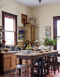 Billy Reid.Salvaged Kitchen  The kitchen is a lesson in creative reuse: Almost every piece of furniture was made from wood salvaged from the renovation of the house. The backsplash is made of bricks from the basement; the sink is set into an old gardening table.