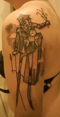 33 cartoon arm tattoo