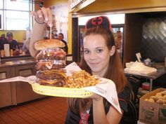 Hostagality - The Heart Attack Grill. The wait staff are dressed as nurses and two people have left the restaurant on a gurney. In the last month. Hospitality gone awry indeed.