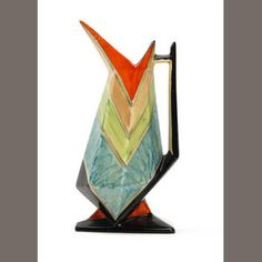 A Rare Myott 'Beaky' jug  Circa 1920-30  The jug of geometric tapered from with pointed spout, painted to the exterior with segmented orange, green and blue glazes, extending to a triangular shaped black painted base;  gold printed factory marks and pattern number B.G.62, impressed number 24, 23cm high.