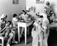 These nurses are feeding babies at Karitane Home, New Zealand
