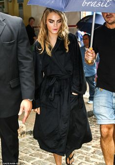 Working girl: Cara steps out of her hotel for another photo shoot day in Rio de Janeiro, Brazil.