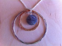 Lookie what I just made!    I N F I N I T Y CIRCLES Silver and Gold Hammered by MandyLemig, $62.00