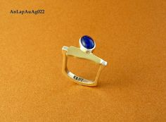 img.elo7.com.br product zoom 10B716E anel-prata-950-ouro-18k-e-lapis-lazuli-azul.jpg