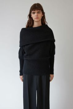 Acne Studios Daze Mohair black is a compact mohair sweater with an exaggerated fold over collar and fitted, ribbed sleeves and hem.