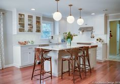 Transitional white kitchen shows off the homeowners tasteful interior decorating style in this Leola PA kitchen renovation. Check out the post for more!