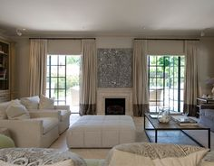 Like the curtains, would be easy to DIY by adding a panel onto pre-made panels.  interior design by Marco Meneguzzi