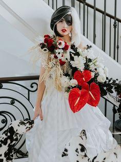 cruella bride with red bouquet