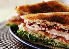 Deli-style Turkey Cranberry Sandwich...  Spread mayo on one slice of bread, and softened cream cheese on the other. Build the sandwich in the following order (omit or add items to taste):    Sliced Bread,  Mayo,  Lettuce,  Sprouts,  Cucumber slices,  Tomato slices,  Red Onions,  Turkey Slices,  Cranberry Sauce,  Cream Cheese,  Sliced Bread.    Serve with potato chips and a deli-style pickle for the perfect lunch!