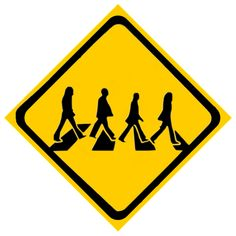 a road sign telling drivers about people crossing the road