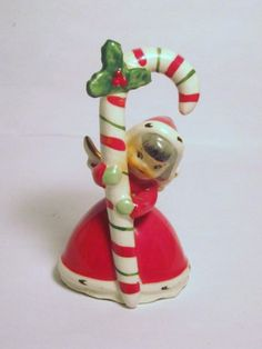 Vintage Christmas Candy Cane Pixie Elf Angel Bell Porcelain Figurine Napco Ornament Decoration Japan Napcoware National Potteries Girl by BrilbunnySelections on Etsy https://www.etsy.com/listing/178221066/vintage-christmas-candy-cane-pixie-elf