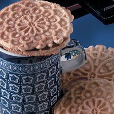"""These caramel-cinnamon treats elevate the term """"sandwich cookie"""" to new heights!   Note:   You must have a pizzelle (or krumkake) maker, preferably a """"mini,"""" to prepare these. Stroopwafel Recipe, Pizzelle Recipe, Pizzelle Cookies, Cookies Et Biscuits, Waffle Cone Recipe, Dutch Cookies, Crepes And Waffles, Bacon Jam, King Arthur Flour"""