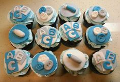 Casey's baby boy shower cupcakes! Blocks, buttons and bottles! Chocolate cake with a sweet vanilla filling.