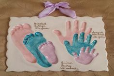 Sibling foot and handprints in clay
