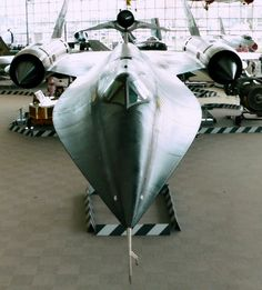 """This M-21 is a unique variant of the A-12, the earliest Blackbird type. Built for a CIA program code-named """"Tagboard,"""" the M-21 carried unpiloted vehicles for intelligence gathering. These drones were intended for launch from the M-21 """"mother ship"""" for flights over hostile territories. Design features of the M-21 include the second seat for the Launch Control Officer and the launch pylon on which the drone is mounted."""