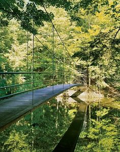 The rambling Hudson Valley family compound includes a suspension bridge over a stream that bisects the property: On one side are the grounds where the main house sits, and on the other is the newly developed area where the younger generation of Mensches has houses