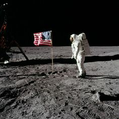 Apollo 11 astronaut Edwin Aldrin poses for a photo beside the US-Flag on the Moon. 20 July 1969, author Neil A. Armstrong