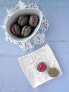 Squid ink colored macaron with beetroot, white chocolate cream