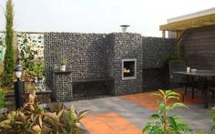 Gabion outdoor fireplace + fence