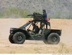 Raytheon HY-DRA.  Hybrid diesel-electric military attack vehicle. Fitted with a Dillon Aero Gatling Gun. <<< repinned by http://www.geistreich78.net