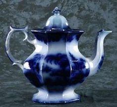 Flow blue tea pot