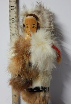 A personal favorite from my Etsy shop https://www.etsy.com/ca/listing/211806085/vintage-inuit-eskimo-doll-with-a-doll-of