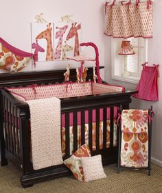 The Sundance 7pc crib bedding set by Cotton Tale Designs is a bright and beautiful set, combining hot pink, tan, and orange. The Sundance 7 Piece Set includes: crib sheet, coverlet, dust ruffle, diaper stacker, pillow pack, toy bag, and valance.
