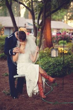 I've said it before and I'll say it again. I absolutely LOVE it when I see a bride rockin' a pair of cowboy boots on the big day. Love. It. And not only did thi
