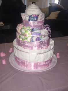 Melissa's cloth diaper cake :) Flats on the bottom, OS pockets and covers in the middle and newborn covers on top