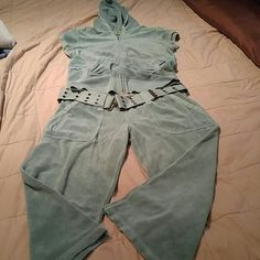 Light green shirt sleeve jacket and Capri pant Sweat suit juicy outfit little lighter mint green, top size large and bottom Is a medium Juicy Couture Tops Sweatshirts & Hoodies