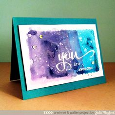 handmade card ... awesome watercolor background wash in purples and turquoise ... water splats too ... luv the look of the white embossed YOU on top ... fab card!