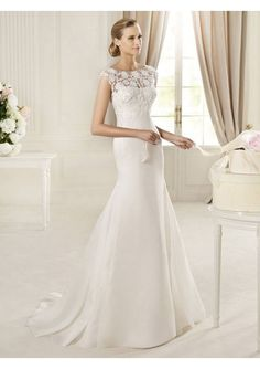 Beautifully elegant and simple wedding dress with a laced top.