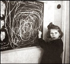 A girl who grew up in a concentration camp draws a picture