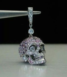 18 carat Gold Pink Sapphire and diamond skull pendant. .yes please!