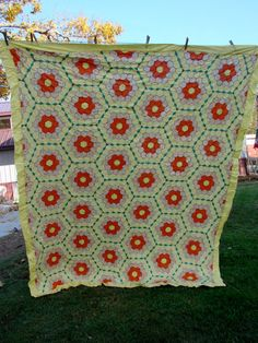 Make sure to check my Etsy shop for more vintage quilt tops and textiles.    This is a very pretty hand pieced Grandmas Flower Garden quilt top with a yellow path.    Its a beautiful all cotton Kentucky made quilt top.    A few light stains from being stored but otherwise good.    Measures approx 72 x 82.