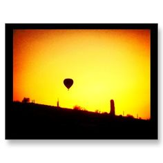 Sunsets and Hot Air Balloons.  Pic taken from my backyard looking out to the Arizona desert as the sun was setting.