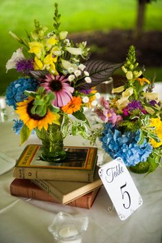 books and fresh flowers for centerpieces