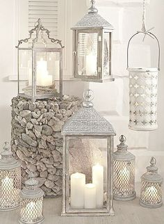 Paint the random lanterns or candle holders to match each other. in 2019 Deco Restaurant, Lanterns Decor, Silver Lanterns, Decorating With Lanterns, Shabby Chic Lanterns, Indoor Lanterns, Hanging Candle Lanterns, Vintage Lanterns, Moroccan Decor