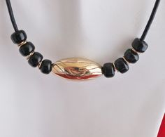 Handcrafted Large Bronze Etched Melon Bead with Black Beads on Black Leather  Cord........Handcrafted by Kaminski Jewelry Designs