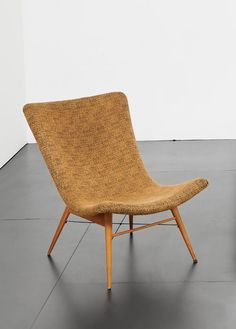 Miroslav Navrátil; Beech and Enameled Metal Lounge Chair for the World Exposition in Brussels, 1958.