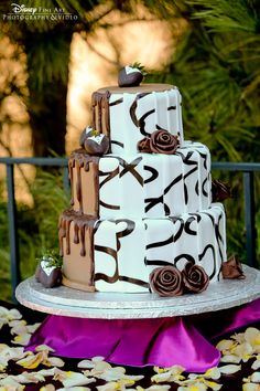 Black and white wedding cake with chocolate covered tuxedo strawberries #Disney