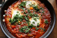 Shakshuka a.k.a. eggs baked in a spicy onion, pepper and tomato sauce.