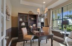 Transitional Home Office with Pendant light, Carpet, High ceiling, Hardwood floors