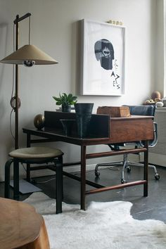 Brad Ford ID, New York Apartment, mid century desk with shelf, Andree Putnam standing lamp, Remodelista