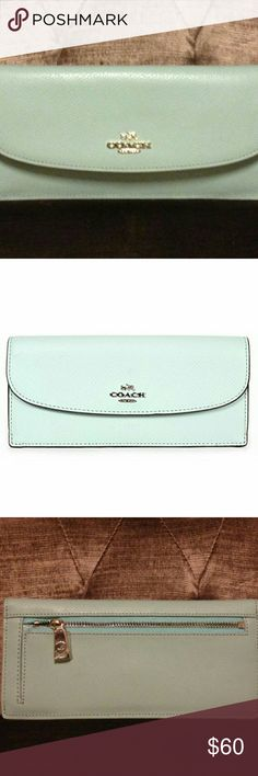 NEW Coach Leather Soft Slim Wallet -New with tags -Silver hardware -Snap closure -One exterior back zip pocket -Eight credit card slots -1 bill compartment -Approx. 7.75 inches x 3.5 inches  NO TRADES. PRICE FIRM. Coach Bags Wallets
