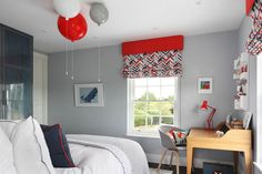 A grown up palette of grey, blue and burnt orange turn this boys bedroom into a cosy, contemporary space with John Moncrieff balloon lights adding a quirky fun element.