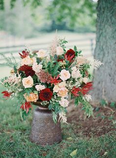 peach juliet roses, hypericum berries, peach astilbe, burgundy dahlias and greenery arrangement by Sage Nines Event Production