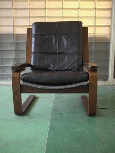 Chair has an interesting design, cover is not real leather though, easily be adapted so that it is. I think this was made in the late 80s or early 90s, yet not sure, Any questions ask. Free shipping.